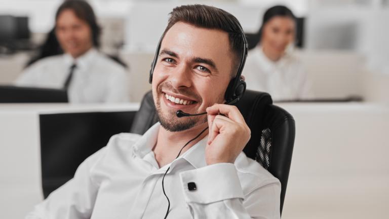 man using VoIP phone service